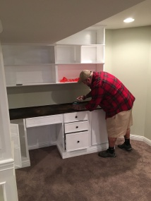 Perfecting the desk surface in the home office of the finished basement.